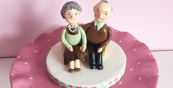 Elderly couple cake topper